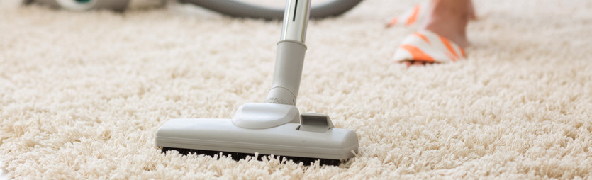Vacuuming a long pile carpet
